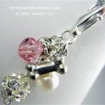 pink crystal dog bone pendant